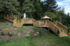Multi-tiered detached deck near yard.  Unusual for a deck to be unattached from the home. But I like it!
