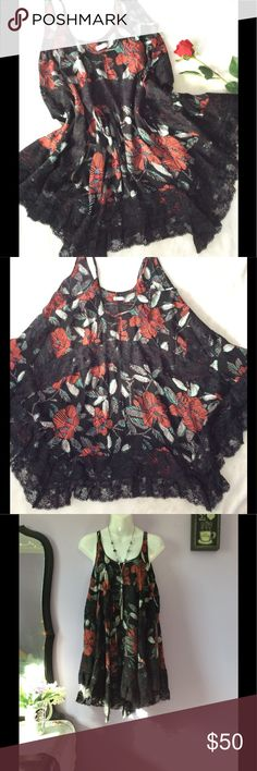 ✨HP✨🖤NWT Free People Black Tunic 🖤IntimateLy Free People NWT Size XS Tunic Black with Red Grey Teal Blue Trimmed with Black Lace Shell 100% Rayon  Lace-100% Nylon 36in Shoulder top to longest part of hem 33in Shoulder top to shortest part of hem 21in Armpit to Armpit Free People Dresses