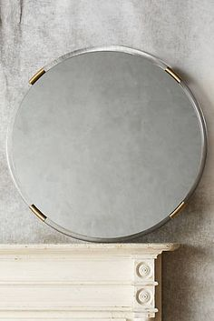 Brass-capped mirror | Anthropologie | $598