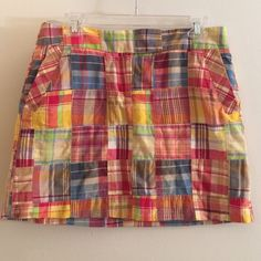 J. Crew Madras Patchwork Skirt Skirt is in great used condition. No rips, stains or holes. Waist is 15.5 inches across. Length of skirt is 15 inches. Has zip fly and two hooks to fasten at the waist. Two pockets in the front and two pockets in the back. 100% cotton. J. Crew Skirts