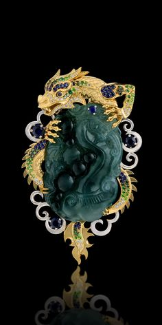 """Brooch from the Master Exclusive Jewellers collection """"Mysticism"""".18K yellow and white gold, carved jadeite cabochon, diamonds, black diamonds, green diamonds, blue sapphires, tsavorite & demantoid garnets."""