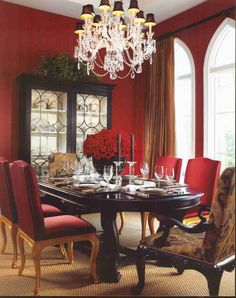 Red dining room with white trim and this dining room table....*mix of upholstered chairs, black or brown table tho' side chairs' wood is light