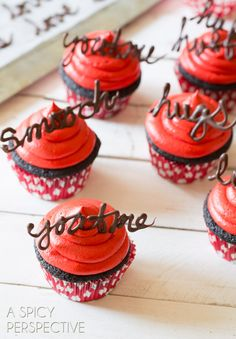Love the handwritten chocolate decorations on these Chocolate Cupcakes with Red Velvet Frosting