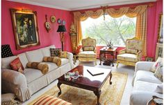 "Randy MacDonald and Darcy Kaser's living room isn't exactly understated. The walls are painted in Diva Rose in what Randall lovingly refers to as this ""Petit Versailles."""