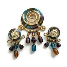 This is a fabulous Vintage Egyptian Style Teal, Purple & Amber Enameled Brooch or Pin and Earrings Demi Parure Set!   This set is vibrant and beautiful – good size statemen... #teamlove #ecochic #vogueteam