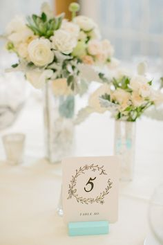 Photo: Emily Delamater Photography #centerpieces #tablenumbers