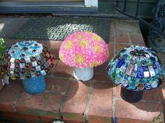 more yard art ideas....make mushrooms,   with a bowl, a jar or vase, and colored pebbles, mosaic, etc.