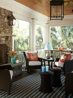 screen porch: wood ceiling, stone fireplace, columns