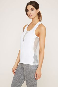 A sleeveless athletic knit top featuring an open mesh-paneled design with moisture management and a racerback.