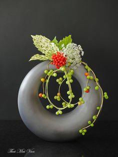 """Free style """"Jewelry"""" ~ by Flowers & Ikebana Thai Mai Van (via Facebook) - green berries, Viburnum, meadow flowers, Dracena leaf and Ivy leaf"""