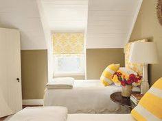 Bright, cheerful attic guest room