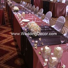 Wedding Decor  Head Table - dusty rose linens, platinum runners, hydrangea and light pink dendrobium orchids in vases with floating candles