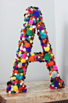 DIY Pom-Pom Monogram Piggy Bank | Community Post: 15 DIY Pom-Pom Projects For Jazzing Up Everyday Items