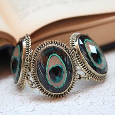 Peacock Bracelet! i love!  it has an antique feel but incorporates the only trend ill actually follow!