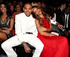 Chris Brown and his girlfriend Rihanna sat in the front row at the Grammy Awards four years after his brutal attack on the pop singer