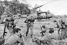Viet Cong Soldier | Australian soldiers prepare for evacuation in a Iroquois chopper