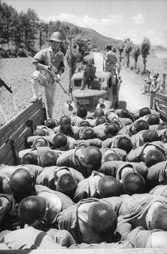 Suspected South Korean traitors are herded into lorries on their way to execution during the Korean War, July 29, 1950 -   The Bodo League massacre was a massacre and war crime against communists that occurred in the summer of 1950 during the Korean War.