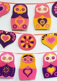 Halloween Special - Russian Doll Day Of The Dead Garland Papercraft - by Happy Thought - == -  Russian Dolls and Day of the Dead - what's not to love?! Download our free garland and add instant cuteness to your Day of the Dead or Halloween celebrations. The nesting doll garland features colourful hearts, flowers and Sugar skull or Calavera dolls. - Happy Thought