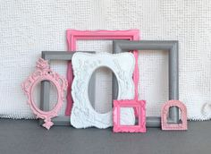 Pinks, Grey White Smaller Frames Set of 7 - Upcycled Painted Ornate Frames Girls or Nursery bedroom decor. $42.00, via Etsy.