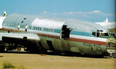 Retired American Airlines 727 lies dead at the boneyard.