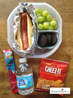 Hot dog, grapes, oreos, yogurt, water and crackers. Add condiment packets to lunch box for hot dog