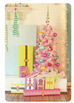 Tree for little miss: pink with aqua, yellow, pink, red, green, and blue ornaments.