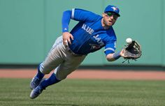 Blue Jay takes flight: Kevin Pillar of the Toronto Blue Jays makes a diving catch against the Boston Red Sox in the eighth inning on April 18 in Boston. The Blue Jays won - © Michael Ivins/Boston Red Sox/Getty Images Kevin Pillar, Baseball Wallpaper, Baseball Posters, Baseball Season, Go Blue, Body Poses, Toronto Blue Jays, Boston Red Sox, Major League