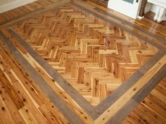 Foyer floor detail Visitors are greeted in the entry by gleaming Australian cypress wood floors. A special herringbone pattern, bordered by a double band of walnut floorboards. Wood Floor Design, Wood Floor Pattern, Herringbone Wood Floor, Herringbone Pattern, Living Room Wood Floor, Living Room Flooring, My Living Room, Wood Tile Floors, Wooden Flooring