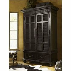 Tommy Bahama Home Kingstown Trafalgar Armoire in Tamarind by Tommy Bahama Home. $3229.00. British Colonial and Campaign styling inspire the Kingstown Trafalgar Armoire with a relaxed traditional look. This armoire pays tribute to British Colonial antiques with louvered doors and a distinctively distressed finish. Wraparound doors open to reveal storage for clothing or media. It displays a timeworn look that guarantees a distinctive design with a sense of a well-traveled l...