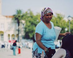 A gipsy woman in Konak trying to sell roses young couples // A #streetscene from #izmir #streetphotography #capturestreets #lensonstreets #fromstreetswithlove #challengerstreets #spicollective #street_perfection #street_photo_club #storyofthestreet #wearethestreet #ourstreets #myspc17 #life_is_street #friendsinperson #vsco_mood #ig_street #ig_photooftheday #lensculture #lensculturestreets #hikaricreative #somewheremagazine #hartcollective #documentaryphotography #sonyimages #sonya7r…