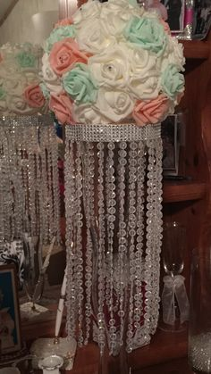 DIY centerpiece chandelier with foam rose heads for quinceanera Bling Wedding, Diy Wedding, Dream Wedding, Wedding Flowers, Wedding Ideas, Quinceanera Planning, Quinceanera Party, Quince Decorations, Wedding Reception Decorations