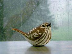 Stoneware Sparrow Sculpture on a rainy day