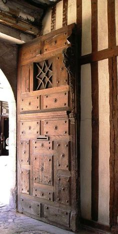 Hand-Carved Door + timber-framed house - Designs From The Historic Record. Would love this...but oh the price is insane, I'm sure!