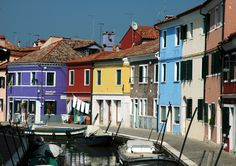 Colorful house along the river in Burano.