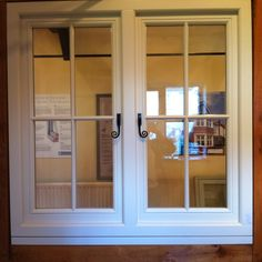 Timber flush casement window with monkey tail handles.