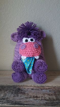 This little crocheted Hippo Pajama Eater is the perfect way to store those pajamas that often fall to the floor each morning. What started as a cute way to encourage wearing the same pajamas for a couple of nights as well as keeping them off the floor and in one spot on their bed or dresser (inside the mouth of this cute little pajama eater) has turned into a way to keep all sorts of treasures safe in such a kid friendly way.