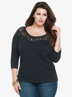 With a sheer floral lace yoke and gold tone studs, this black sweatshirt mixes girly style and edgy attitude. The 3/4 raglan sleeves and open neck give the pullover a relaxed fall-ready look.