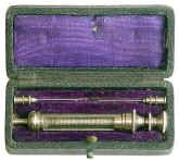 A good quality c. 1880 antique hypodermic syringe set that includes two needles.  Such sets were typically used for cocaine and morphine injection.