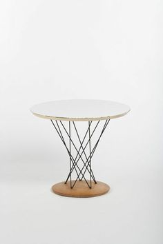 Isamu Noguchi, Cyclone Side Table (circa. 1950s) Laminate top with steel pedestal and birch base 50.8 × 61 × 61 cm
