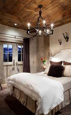 A stunning rustic bedroom. All doors were built by integrity builders, Bozeman MT.