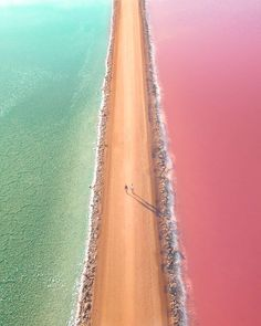 """This week's Travel Thursday takes us to Australia's Lake MacDonnell. This surreal, but stunning stretch of water near Cactus Beach is now nicknamed """"Watermelon Avenue"""": super-high salt concentrations in the lake give the water a bright pink hue. Pink Lake Australia, South Australia, Australia Travel, Australia Funny, Cool Places To Visit, Places To Travel, Travel Destinations, Travel Trip, Florida Travel"""