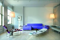 A contemporary purple sofa and lounge chair with a floral motif accent this Soho Loft Of Artist Marina Abramovic | Afflante.com