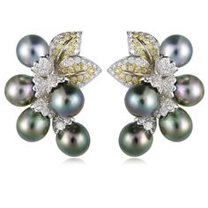 These stylish 18k white and yellow gold earrings, feature 10 grey and black South Sea pearls, of natural color, measuring 9.5mm in diameter, fancy yellow diamonds, weighing .66 carat total and round brilliant cut white diamonds weighing 2.52 carats total