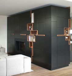 This Creative Wall Of Shelving Doubles As Art - Belgium designer Filip Janssens creates custom furniture pieces tailored to the room it's in, like this wrap-around cabinet in this home's living room. Built In Furniture, Custom Furniture, Furniture Design, Sectional Furniture, Placard Design, Küchen Design, House Design, Design Trends, Interior Architecture