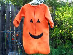 Orange fleece bunting with black fleece smiling Jack-O-Lantern face, a perfect for Halloween costume for baby on a cold October night.  $30