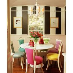 love the different colored chairs with the black and white walls