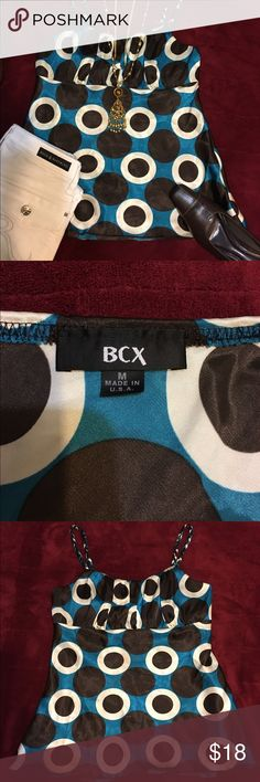BCX Junior's Camisole Top....Size medium Beautiful top that's in great condition. 100% polyester. Worn once with the jeans 👖 in the picture. The straps of the camisole are braided. Which adds a fun and interesting flare to the top. BCX Tops Camisoles