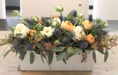 beautiful winter-into-spring flower arrangement (the peach ranunculus are so pretty!)