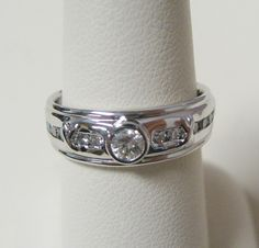 14KW ladies ring mounting for customers diamonds, bezel set center (0.16 ct) and channel set side stones