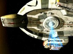 """The USS Defiant with a tractor beam on a Danube-class runabout from the Star Trek: Deep Space Nine episode """"By Inferno's Light"""""""